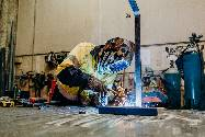 Image of a person welding - Catten Industries